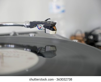 Turntable playing vinyl close up with needle