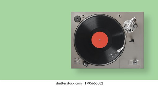 Turntable is playing vinyl LP record top view. Clipping path.
