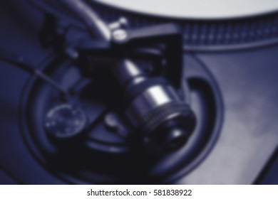 Turntable tonearm weight adjustment. Professional audio equipment.