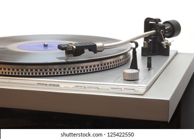 Turntable with vinyl LP isolated on white closeup