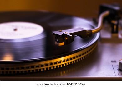 Turntable vinyl record player.Retro audio equipment for disc jockey. Sound technology for DJ to mix & play music. Black vinyl record.
