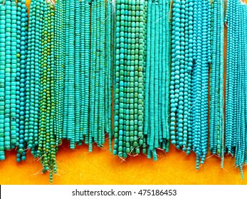 Turquiose bead necklaces at Pangiayuan market in Beijing, China