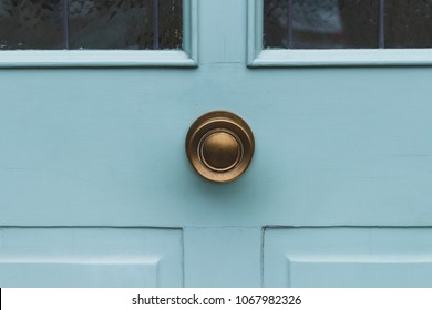 Turquiose dorr with a golden door knob, close up vintage.