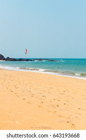 The turquise, sea with a tropical beach. Coastline of the ocean in the summer Querim Beach, Goa, India, active holidays in paradise resorts, concept travel lifestyle.