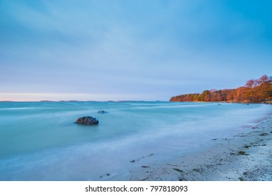 Turquoise beach on sunset time, winter