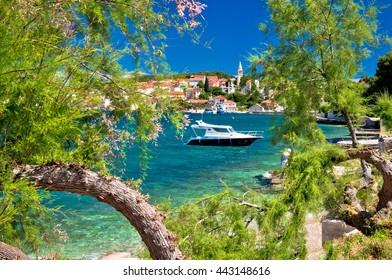 Turquoise beach of Ugljan island and town of Kali view, Dalmatia, Croatia