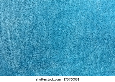 a turquoise blue background of warm, cozy microfleece blanket