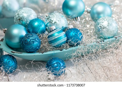 Turquoise and blue Christmas ornament still life