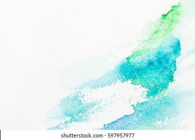 Turquoise, blue, green brush strokes on watercolor paper