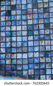 Turquoise blue iridescent glass tile 1 inch squares underwater.