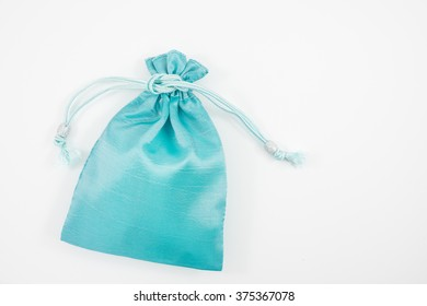 The turquoise blue silk mini gift pouch bag to hold jewelry.