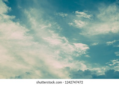 Turquoise blue and white clouds in sky. Vintage colors. For background and wallpaper