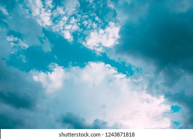 Turquoise blue and white clouds in sky. For background and wallpaper