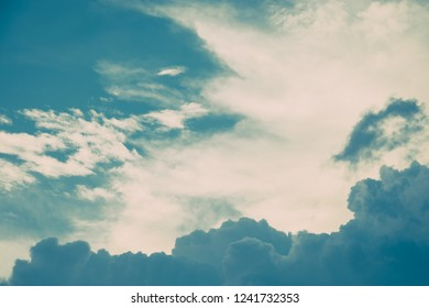 Turquoise blue and white cumulus clouds in sky. Vintage colors. For background and wallpaper