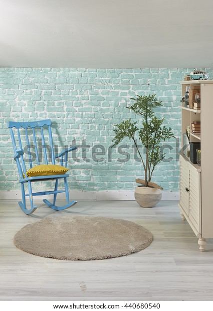 turquoise brick wall home rocking chair and cabinet with flower pot interior decoration