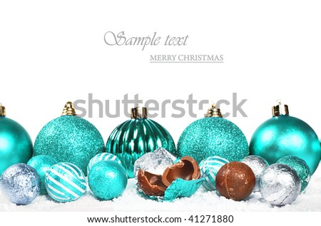 turquoise christmas decorations and chocolates