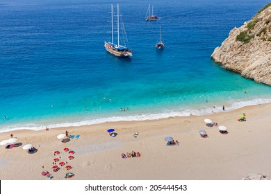 Turquoise Coast with Tourists and Yachts in Antalya, Turkey.