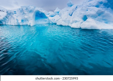 Turquoise color under an iceberg in Antarctica