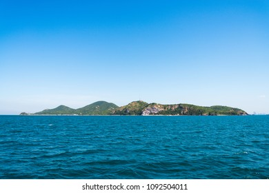 The turquoise colored sea and the island ahead