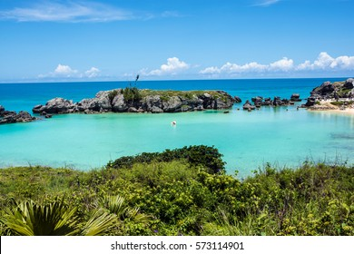 Turquoise colored water of Tobacco Bay, a popular beach in Bermuda.