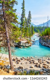 Turquoise colored waters from Tokumm Creek flows through Marble Canyon in Kootenay National Park, British Columbia, Canada, near Banff.