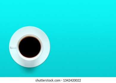 Turquoise cup of coffee on a background of turquoise color
