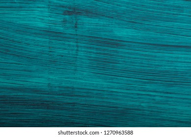 Turquoise Damaged Obsolete Cement Wall Background closeup