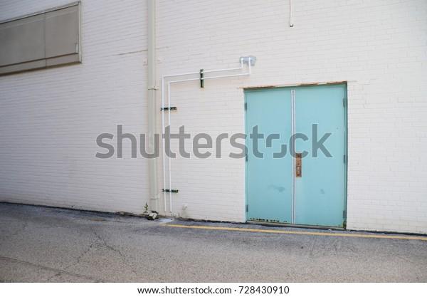 Turquoise Door in Alley