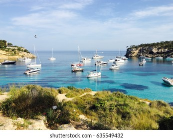 turquoise and emerald lagoon with sailing boats