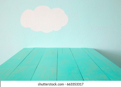turquoise empty table and blue wall.