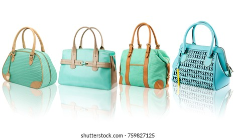 Turquoise female handbags collection on reflected surface isolated on white background.