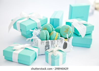 Turquoise gift boxes and macarons