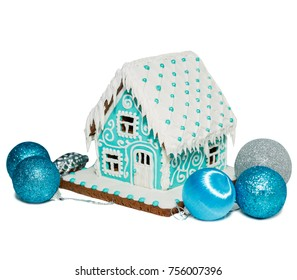Turquoise gingerbread house, christmas. Around the Christmas balls. Isolated on white.