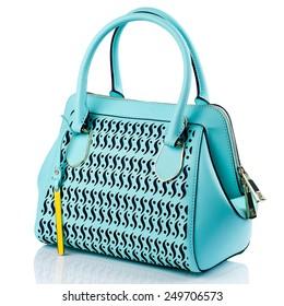 Turquoise handbag isolated on white background.