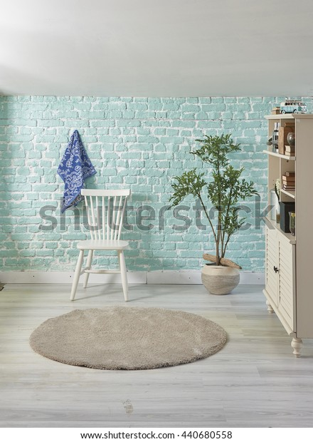 turquoise home white chair and cabinet with flower pot interior decoration