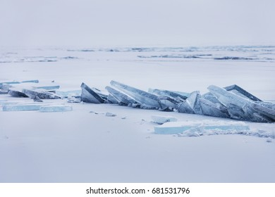 Turquoise ice floe. Winter landscape. Ice-drift of Baikal lake