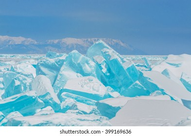 Turquoise ice hummock on the ice of lake Baikal, Russia