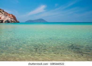 Turquoise lagoon of Plathiena beach at Milos island in Greece