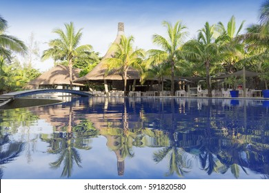 Turquoise lagoons of the tropical island. The beautiful place for restoration of forces, rest, aquatics, suntan and bathing. Warm sea water, white sand, breeze. Beautiful dawn and declines.