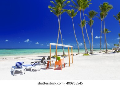 Turquoise lagoons of the tropical island. White sand of the coast. Beautiful place for restoration of forces, rest, aquatics, suntan and bathing. Warm sea water, palms, breeze.