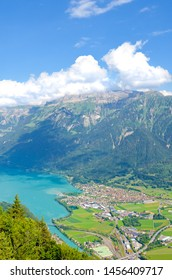 Turquoise Lake Brienz in Interlaken, Switzerland from above from Harder Kulm. Beautiful Swiss landscapes. Green hills, Swiss Alps. Summer Alpine landscapes. Amazing view
