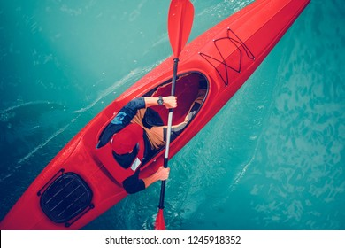 Turquoise Lake Kayak Tour. Kayaker on a Water Taken From Above.
