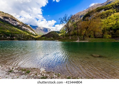 Turquoise lake in the mountains. Lake Tenno. Italy