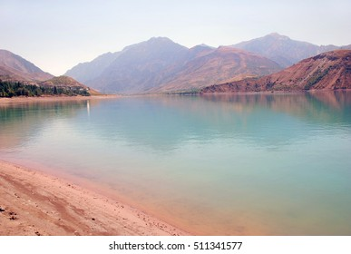 Turquoise lake in pink shores. Uzbekistan