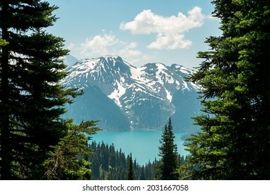 Turquoise lake with snowcapped mountains and trees in Canada