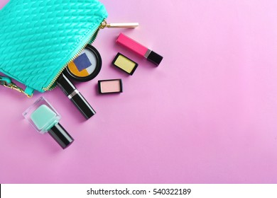 Turquoise make up bag and decorative cosmetics on pink background