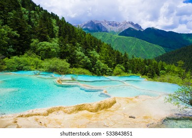 Turquoise mountain lake.  Colorful pools formed by calcite deposits, especially in Huanglonggou (Yellow Dragon Gully).