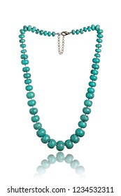 Turquoise necklace isolated on white background.  Beads with natural stone turquoise close-up jewelry