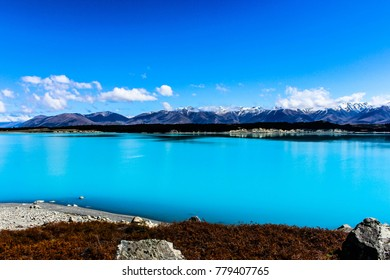 Turquoise New Zealand Lake Against Mountains