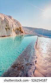 Turquoise pools and white travertine terraces, Pamukkale, Turkey.